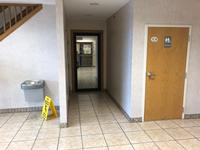 VIEW OF THE LOBBY ENTRANCE INTO TYHE LEX PECUNIA 103 OFFICE LEASE PROPERTY