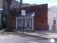 FRONT EAST VIEW OF McGINNIS PROPERTIES 154 OFFICE LEASE