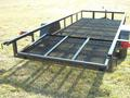 Gate folds over into bed of trailer