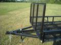 Front gate lets you load a four wheeler in the back of your truck and 2 on trailer.