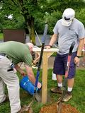 Parks Manager Jim Carpenter and staff install the post.