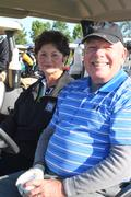 Mary Ann Waelde and husband golf 2010