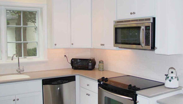 Painted Shaker Style Custom Cabinets with Corian Countertops