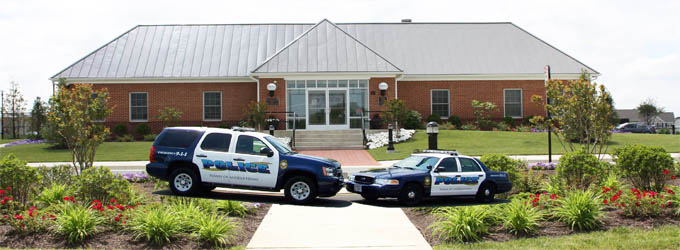 Front of Police Station with two cars