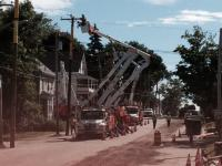 CMP trucks and employees relocate overhead utilities.